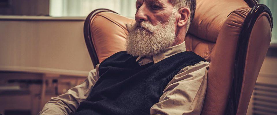 well-dressed-senior-man-in-luxury-interior-PWE39NB
